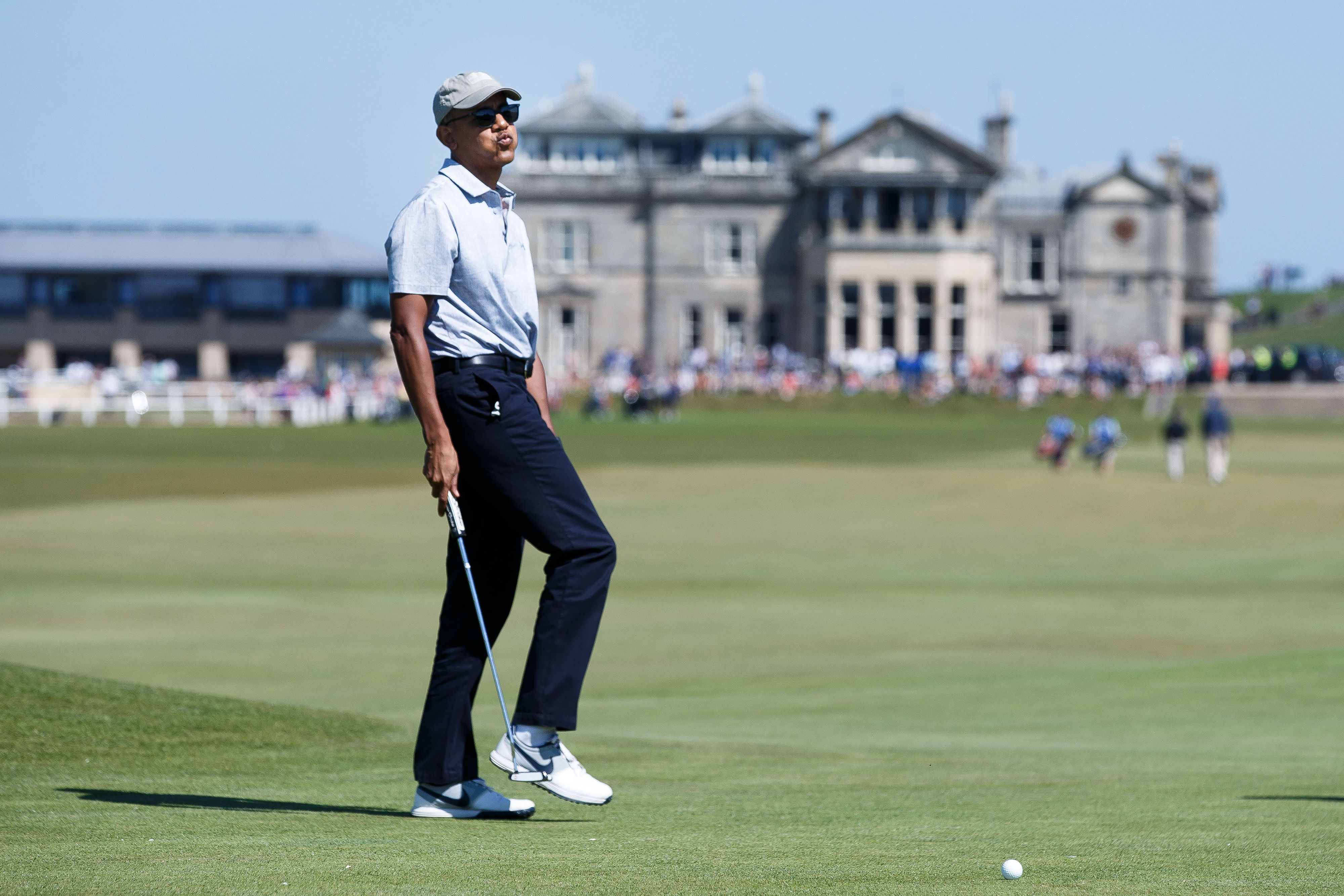 Former President Barack Obama plays golf at the Old Course on May 26, 2017, in St. Andrews, Scotland.