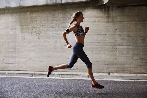 Female runner running on urban street