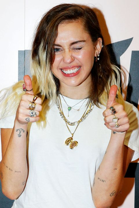 Hair, Hairstyle, Lip, Cool, Long hair, Fashion accessory, Finger, Gesture, Smile, Brown hair,
