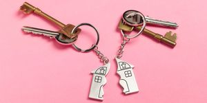 Divorce house keys on pink