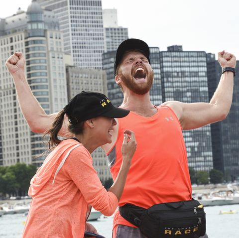 Brooke (left) and Scott (center) are crowned the winners and awarded the 1 million dollar prize on the 29th season finale of THE AMAZING RACE.