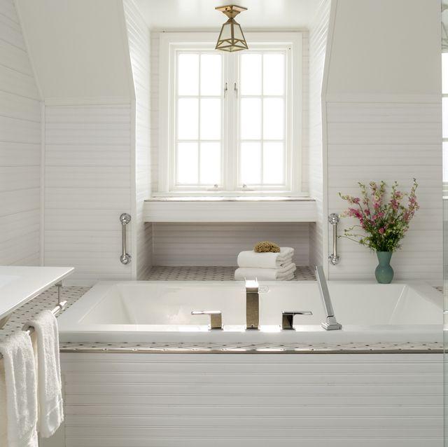 luxury white bathroom with bathtub and tile, settlers inn, hawley, poconos region, pennsylvania, usa
