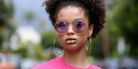 Eyewear, Glasses, Ear, Vision care, Lip, Hairstyle, Earrings, Jewellery, Sunglasses, Fashion accessory,