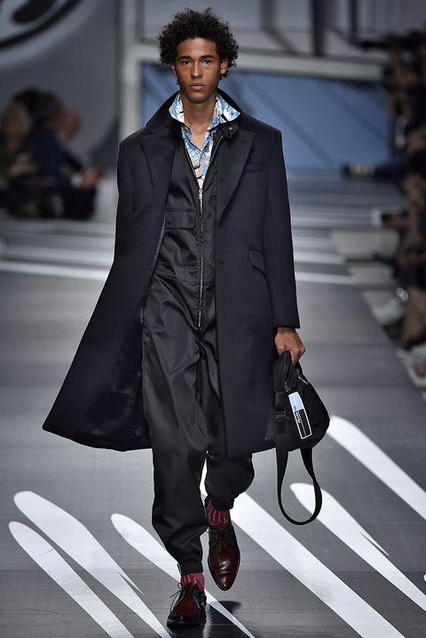Fashion model, Fashion, Clothing, Suit, Runway, Coat, Fashion show, Street fashion, Overcoat, Outerwear,