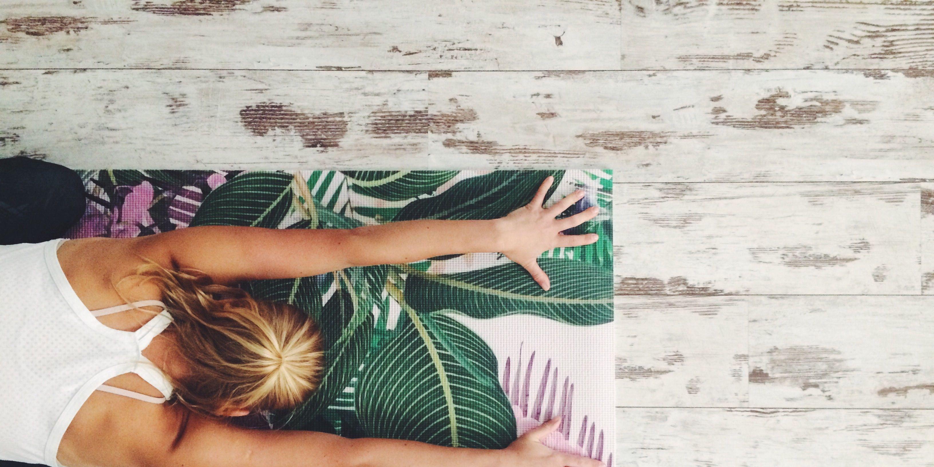 High Angle View Of Woman Doing Yoga