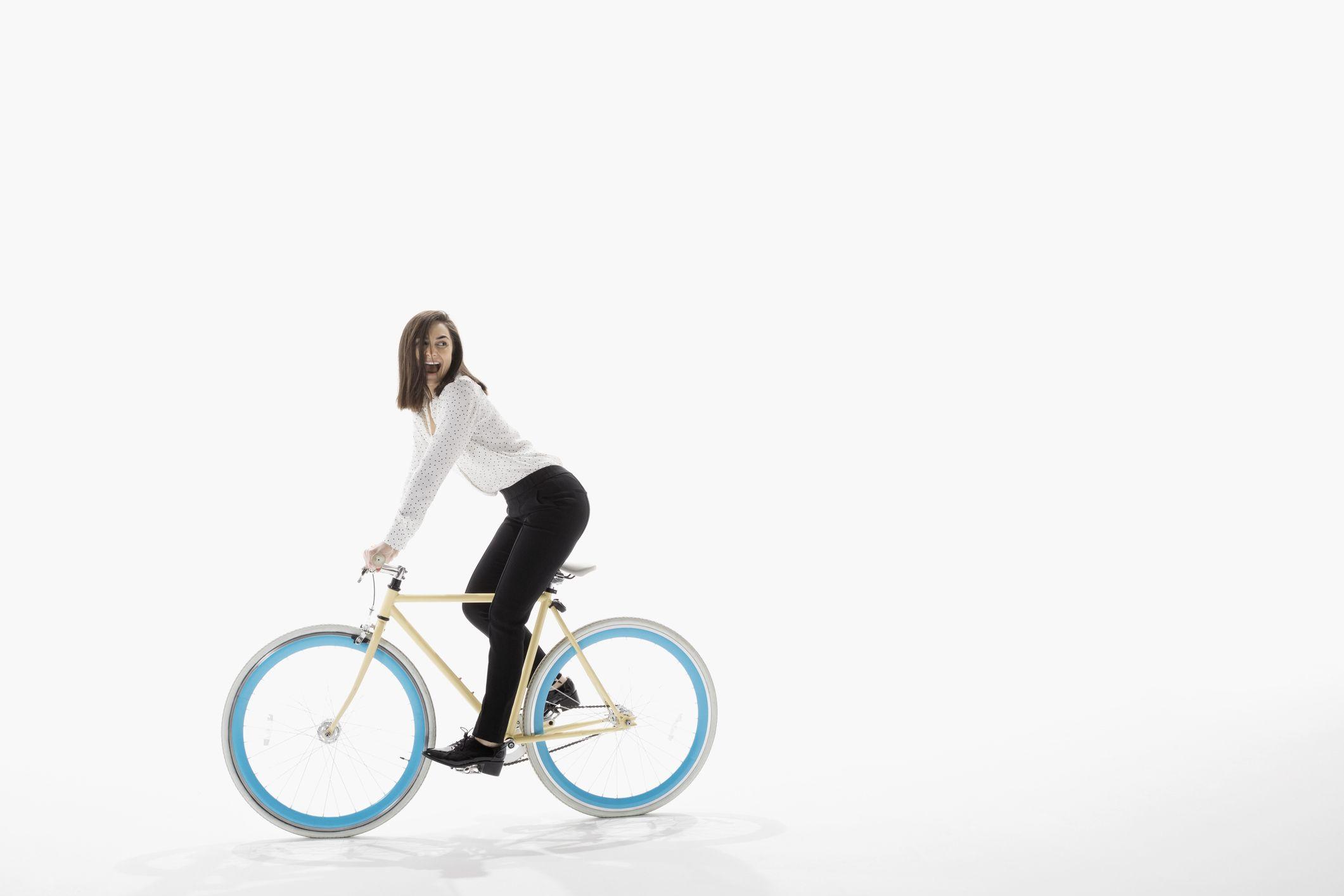 woman riding bike white background