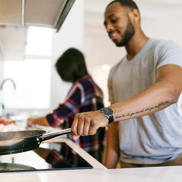 Young couple cooking together at home
