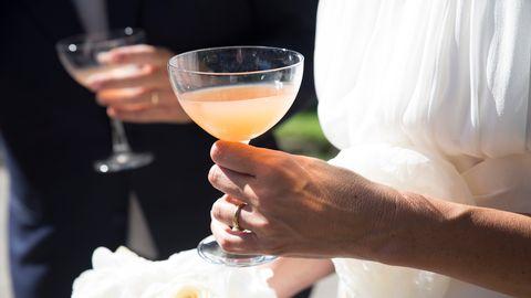 Champagne stemware, Wine glass, Drink, Hand, Stemware, Alcohol, Alcoholic beverage, Glass, Drinkware, Cocktail,