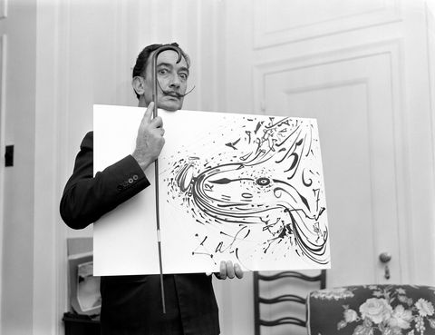 spanish surrealist painter salvador dali 1904   1989 holds up a painting and a cane for a broadcast of the cbs television program person to person hosted by edward r murrow, november 7, 1955 photo by cbs photo archivegetty images