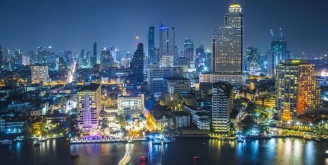 Thailand, Bangkok, City skyline with Chao Phraya river at night