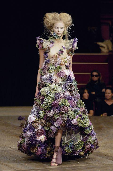 Fashion, Fashion model, Runway, Fashion show, Haute couture, Dress, Fashion design, Purple, Event, Public event,
