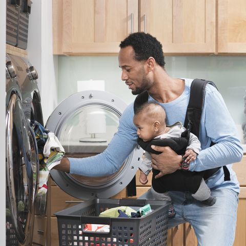 Man does laundry and parenting