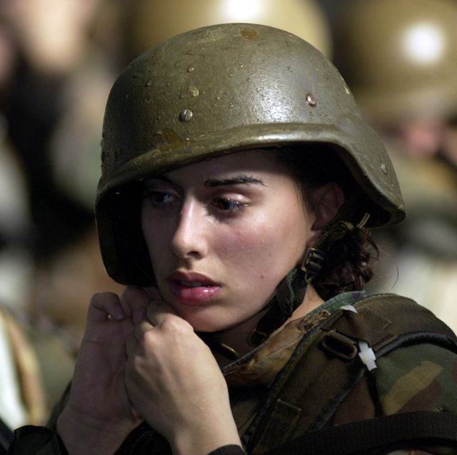 parris island, sc   january 15 united states marine corps female recruit stephanie palladino adjusts her kevlar helmet january 15, 2003 before re entering the combat pool for another swim lesson during boot camp on parris island, sc under the watchful eyes of swim instructors, recruits are required to swim in full gear and learn limited strokes and breathing to stay afloat along with life saving techniques photo by stephen mortongetty images