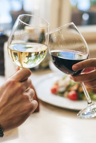 couple toasting with wine, close up