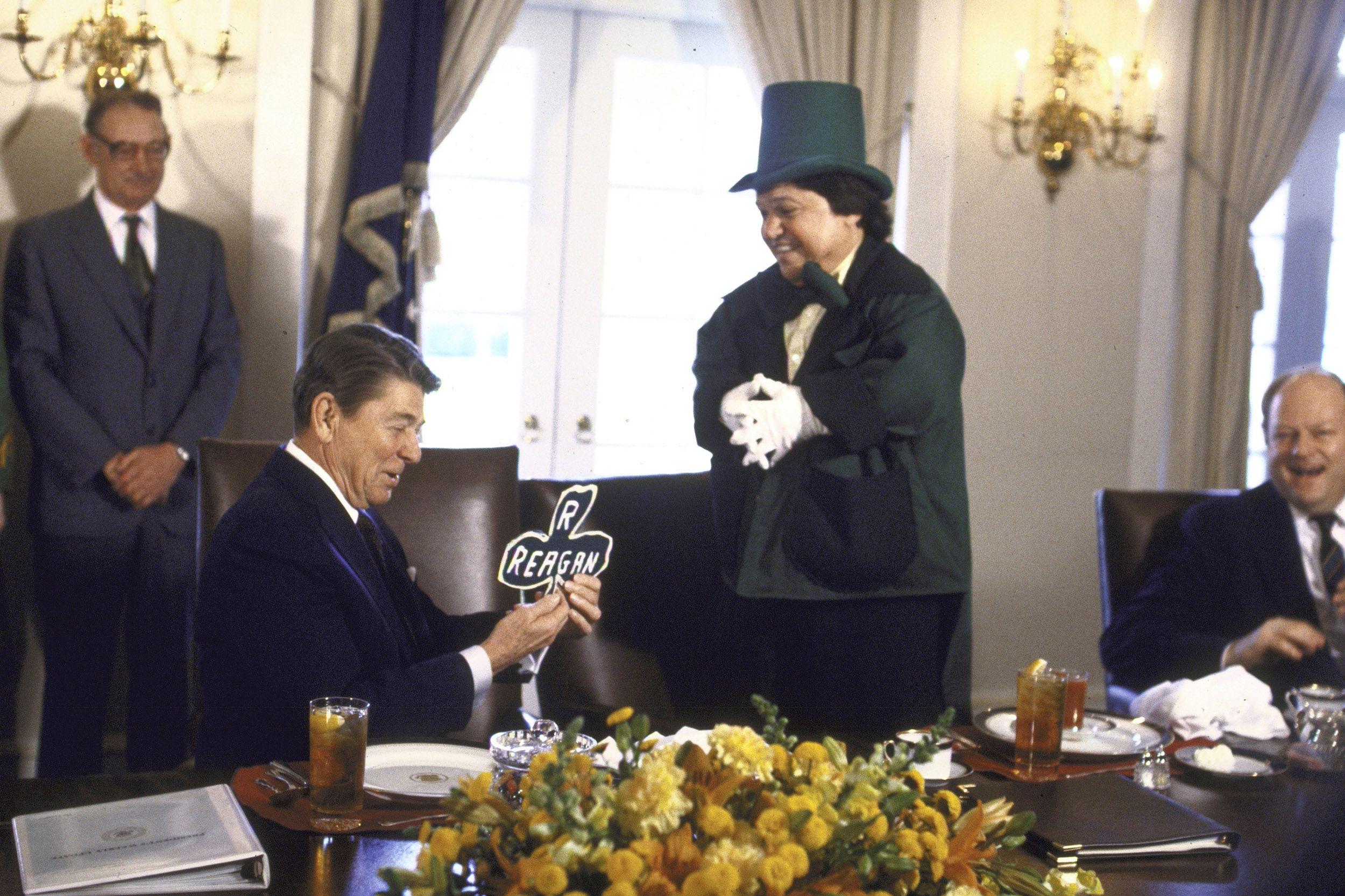 A leprechaun presents President Reagan with a personalized shamrock on St. Patrick's Day at the White House in 1986.