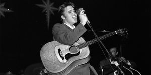 Singer Elvis Presley balanced on toes while singing