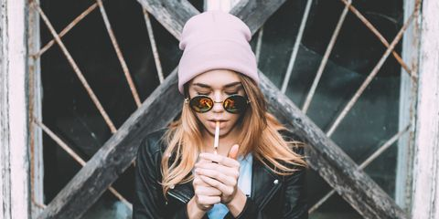Portrait Of Beautiful Young Woman Smoking