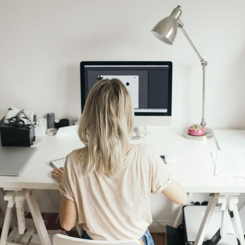 girl sitting at desk work from home