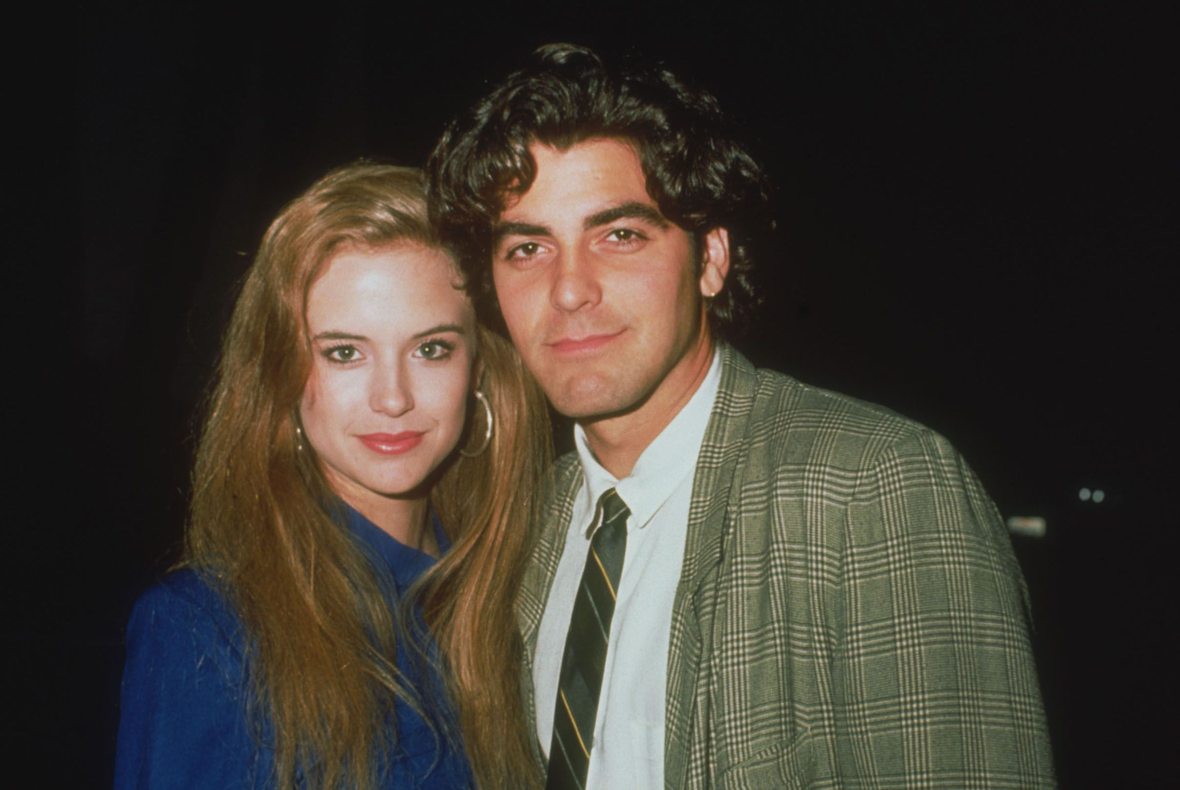 Clooney and Kelly Preston, who he dated and lived with, photographed together in 1985.