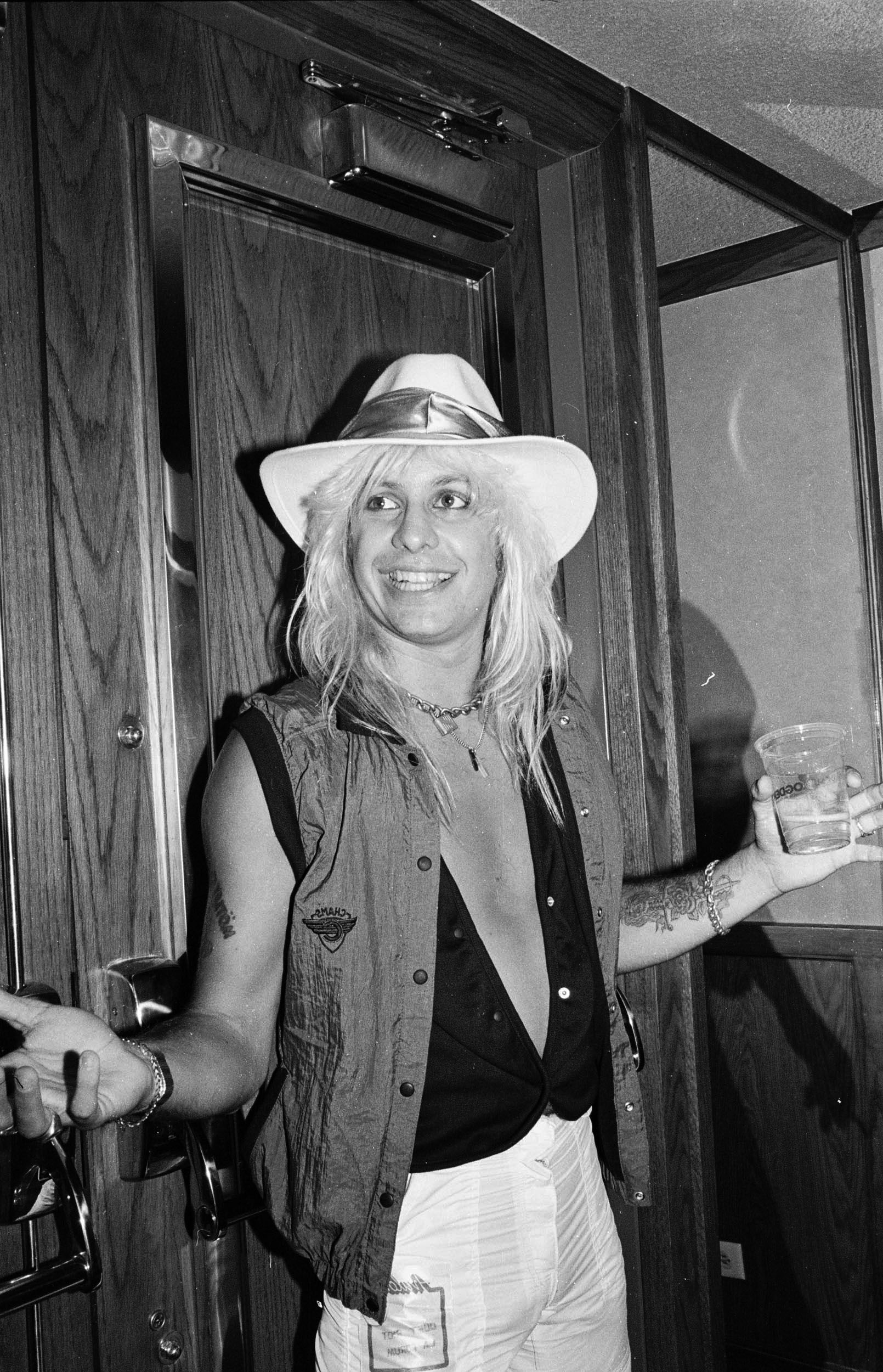 Vince Neil poses backstage at a Quiet Riot concert at the Forum on September 29, 1984.