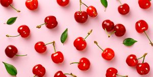 High Angle View Of Cherries On Pink Table