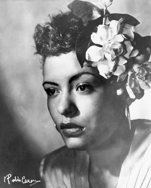 circa 1939 jazz singer billie holiday poses for a portrait in circa 1939 with a flower in her hair photo by michael ochs archivesgetty images