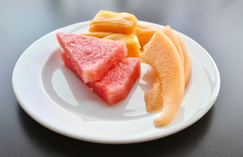 Slices Of Various Fruits In Plate Served On Table