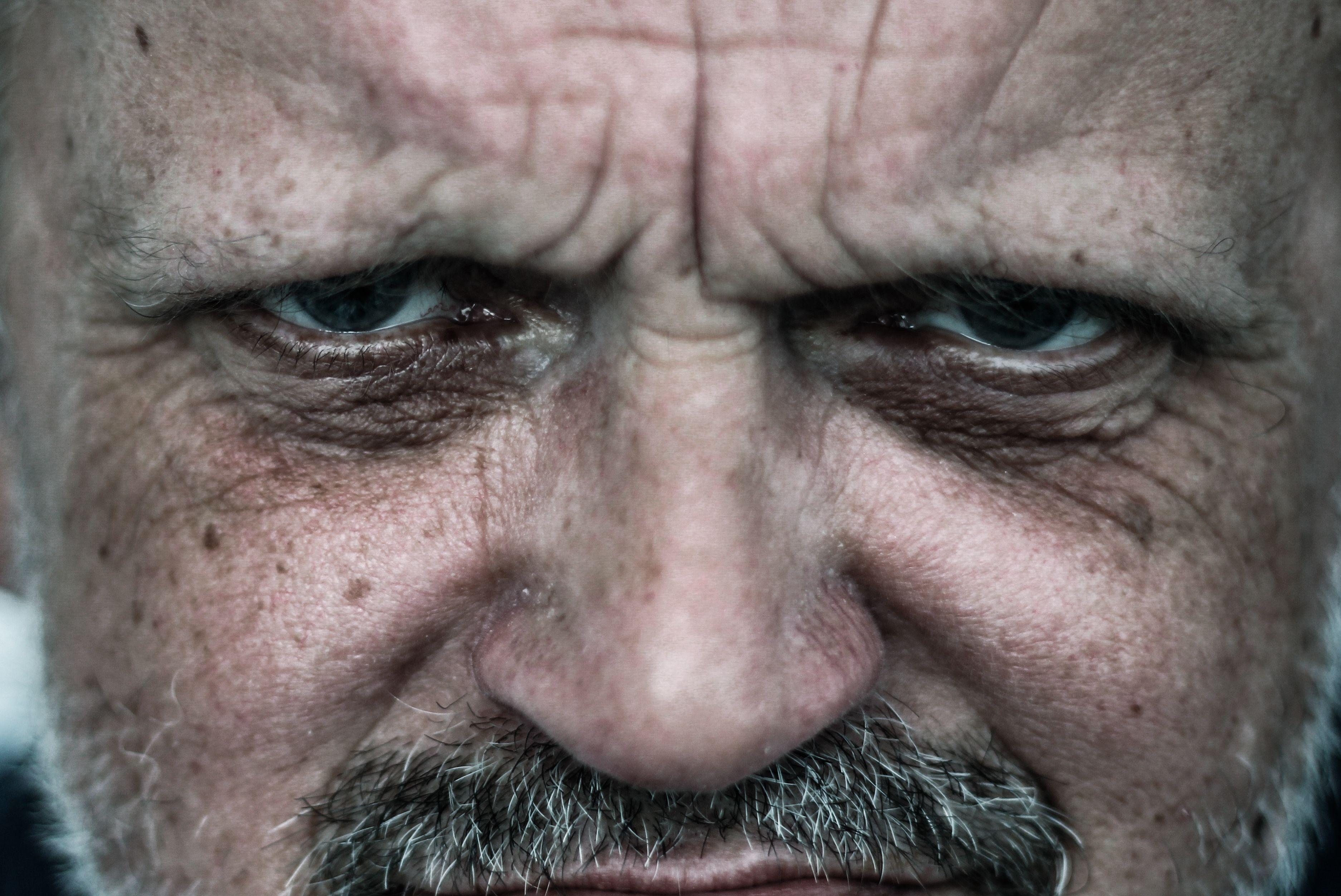 Close-Up Portrait Of Furious Mature Man