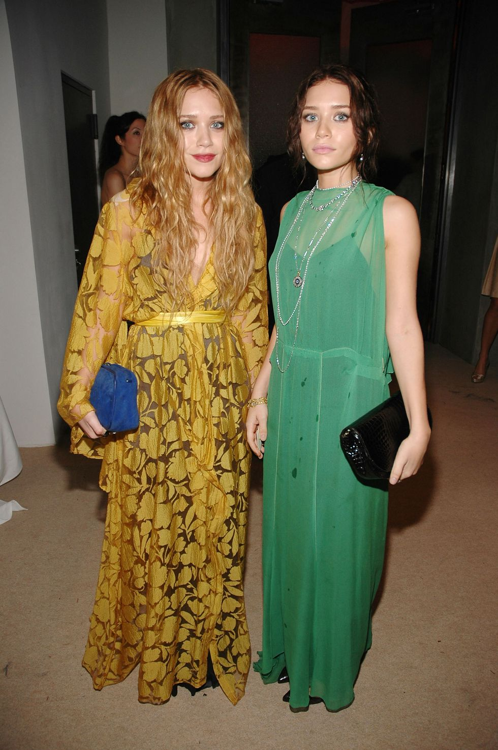 November 16, 2006 At the 2006 CDFA Fashion Awards, the twins wore floor-length dresses in bright mustard yellow and green.