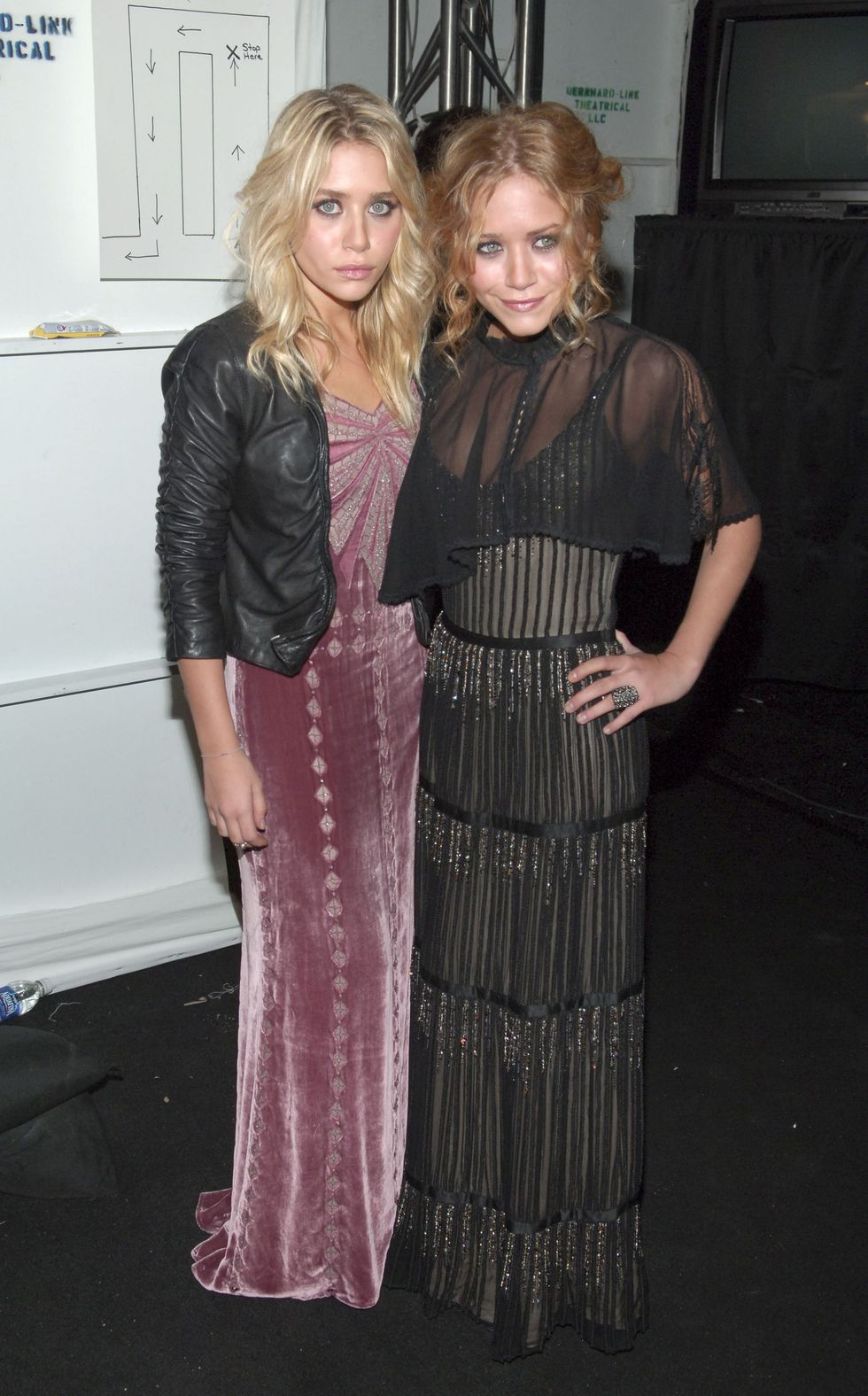 February 5, 2006 The twins stunned backstage at Badgley Mischka's NYFW show, with Ashley in a mauve, floor-grazing velvet gown, and Mary-Kate in a black, sparkling gown with stripes.