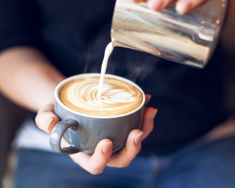 Close Up Of Barista Holding Coffee Cup
