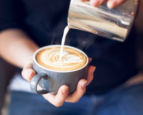 Close-Up Of Barista Holding Coffee Cup