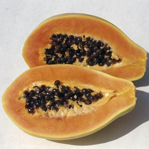 Papaya or Papaw (Carica papaya), cut in cross-section, Caricaceae