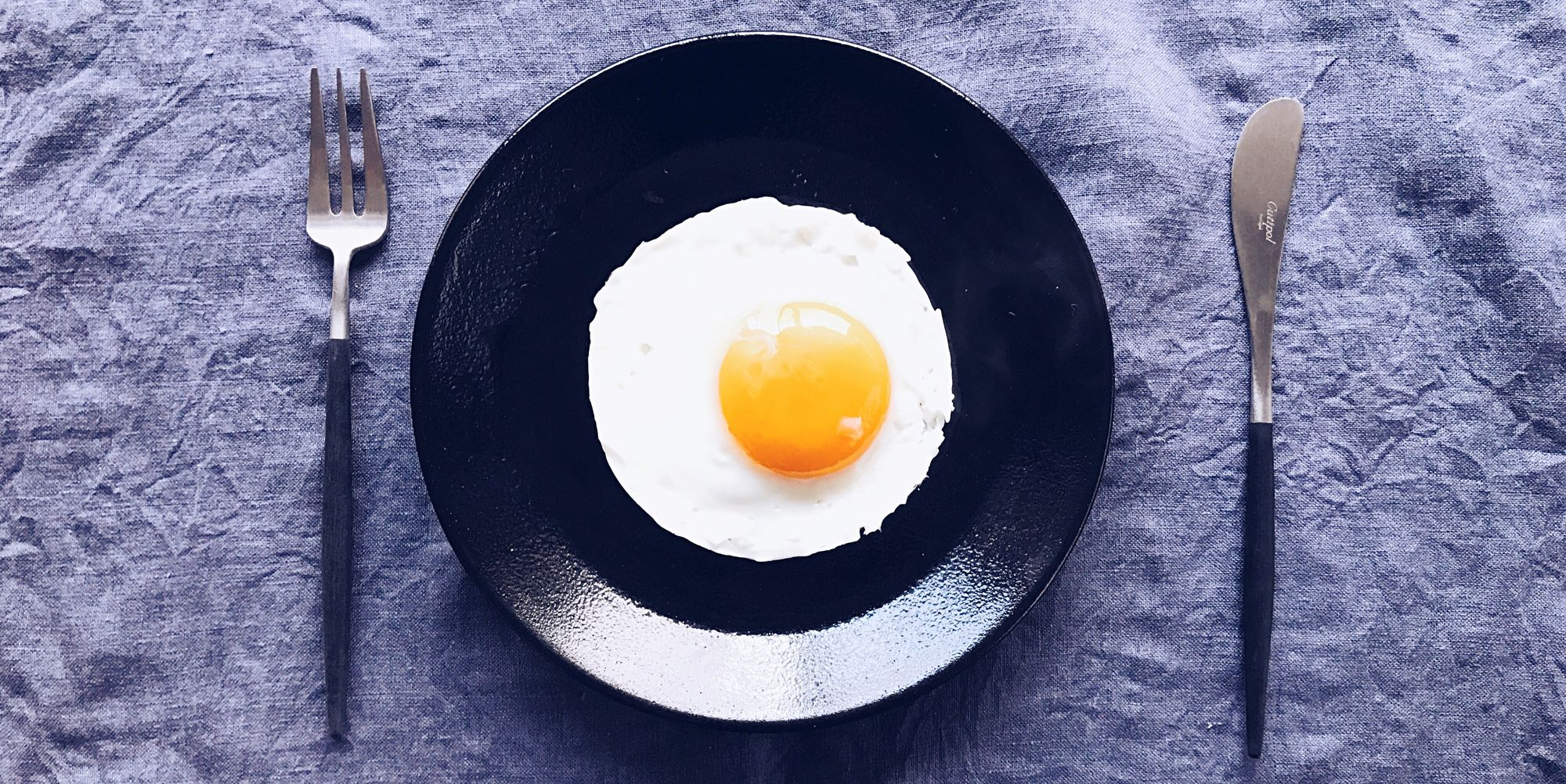 Directly Above Shot Of Fried Egg In Plate On Table