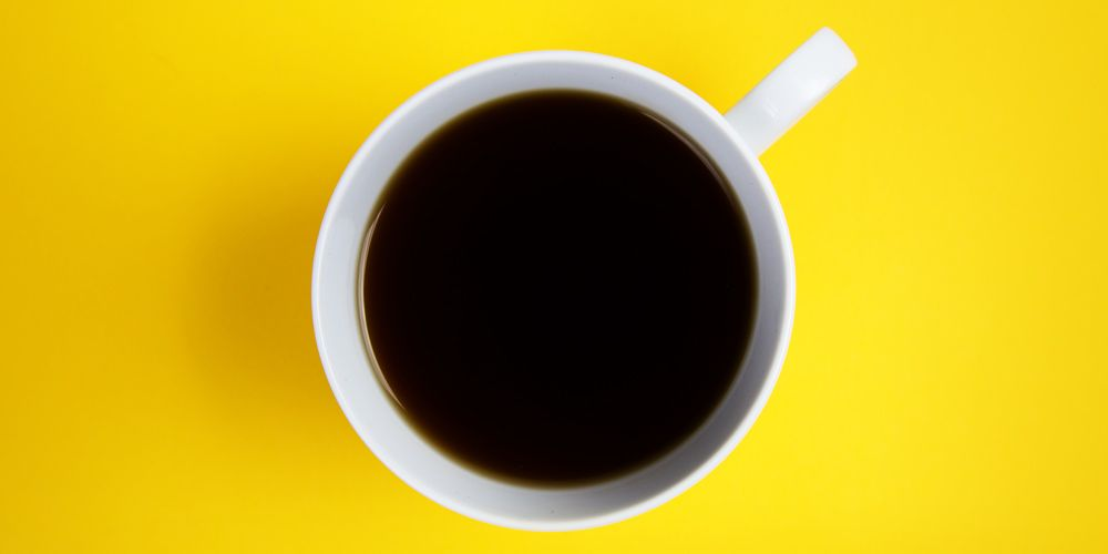 Directly Above Shot Of Coffee On Yellow Background