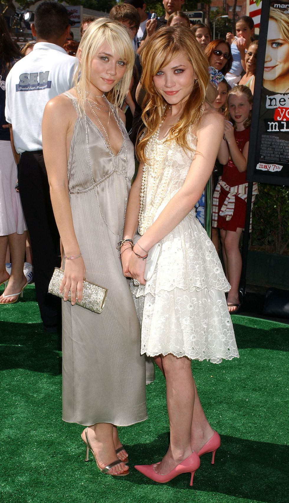 May 1, 2004 A few days later, the twins attended the premiere of their movie, New York Minute . Both went for feminine looks with Ashley wearing a satin slip dress and Mary-Kate in a tiered eyelet dress.