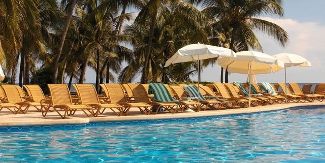 Swimming pool, Resort, Vacation, Leisure, Sunlounger, Tree, Real estate, Hotel, Palm tree, Eco hotel,
