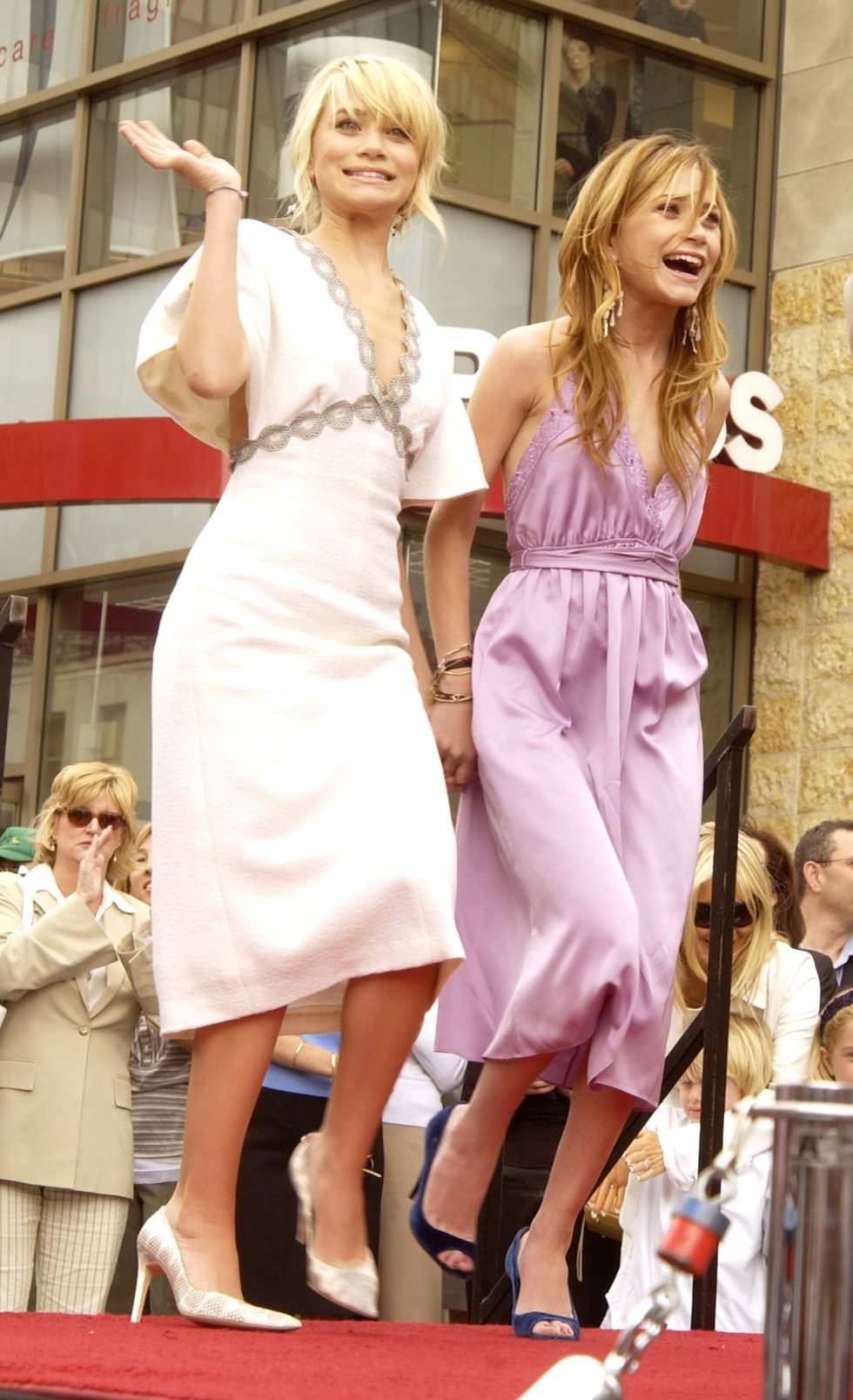 April 29, 2004 For their Walk of Fame ceremony, the girls both wore midi dresses: Ashley in white, Mary-Kate in lavender.