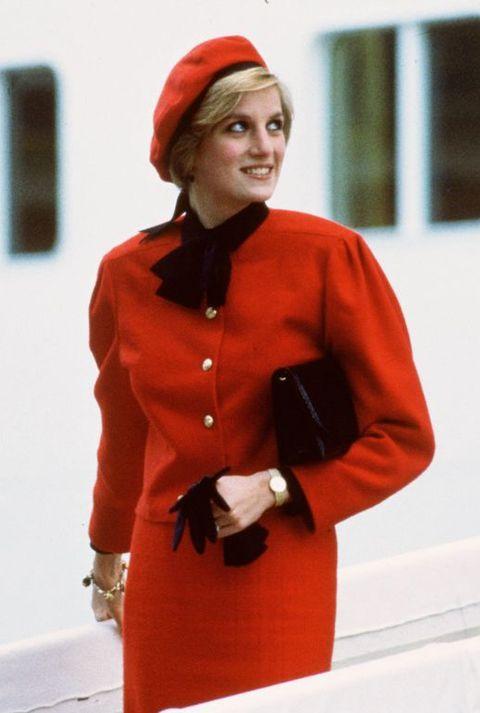 Clothing, Red, Orange, Fashion, Outerwear, Sleeve, Coat, Headgear, Overcoat, Fashion design,