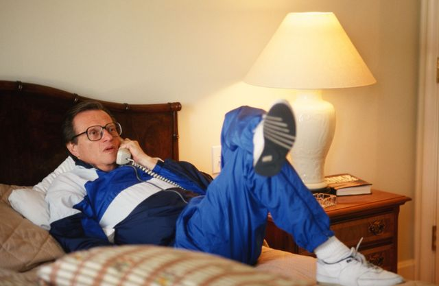 los angles, ca   1990  cnn talkshow host, larry king, reclines on his hotel bed during a 1990 beverly hills, california, photo portrait session kings one hour tv show is viewed by millions throughout the world photo by george rosegetty images
