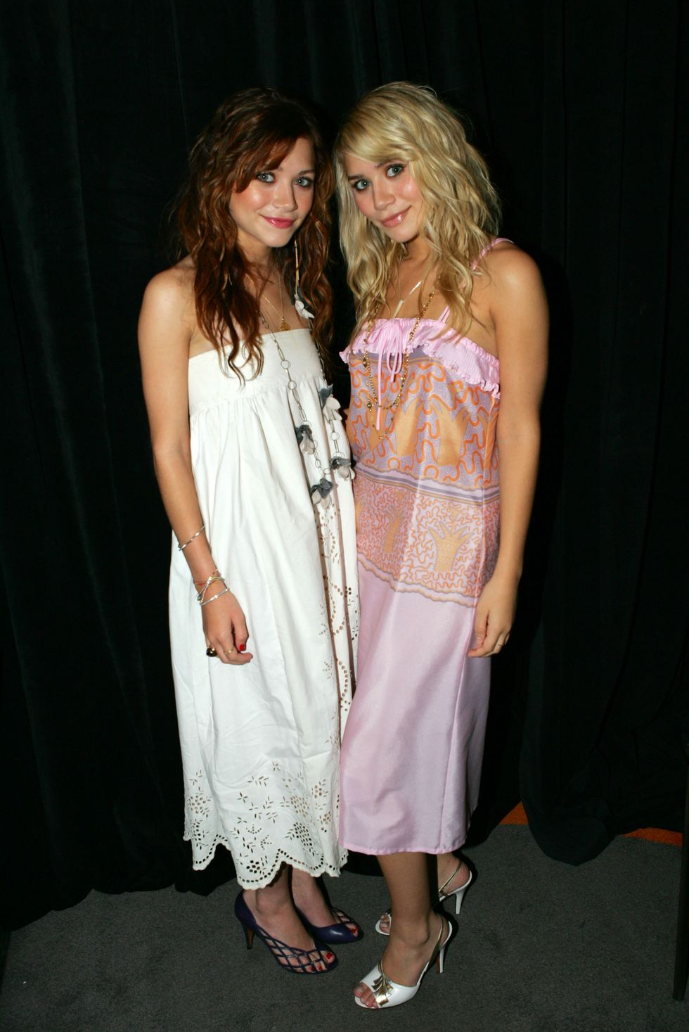 August 29, 2004 The 2004 Video Music Awards saw the twins dressed in similar silhouettes. Mary-Kate kept it simple in plain white, but Ashley jazzed it up with a pink and orange print.