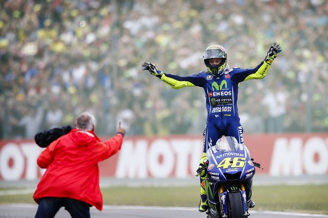 topshot   italys valentino rossi celebrates after winning the assen motorcycling grand prix at the tt circuit in assen on june 25, 2017   afp photo  anp  vincent jannink  netherlands out        photo credit should read vincent janninkafp via getty images
