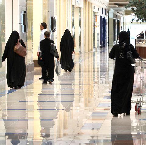 Saudi women walk at a shopping mall in t