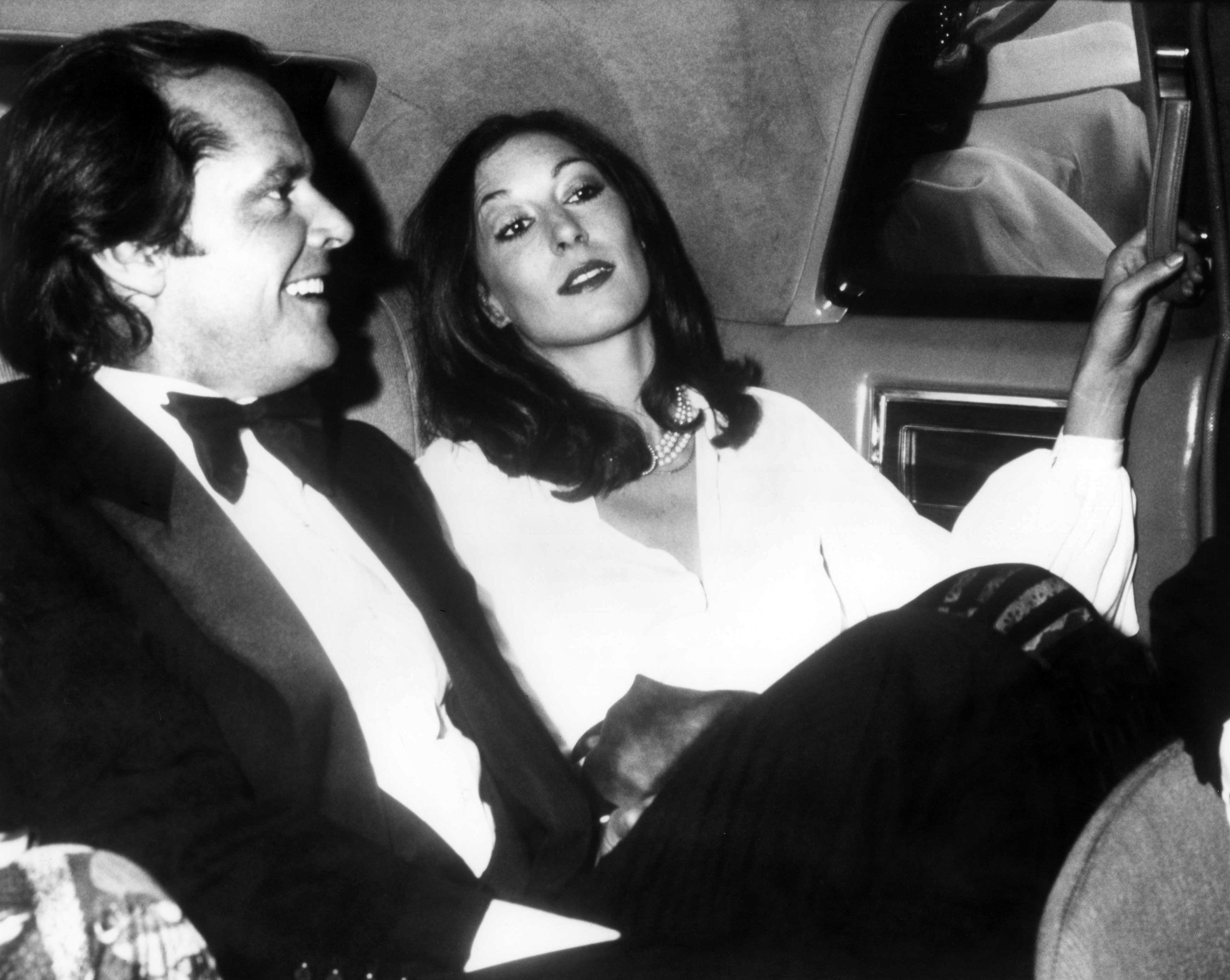 Huston with then-boyfriend Jack Nicholson in the 1970s.