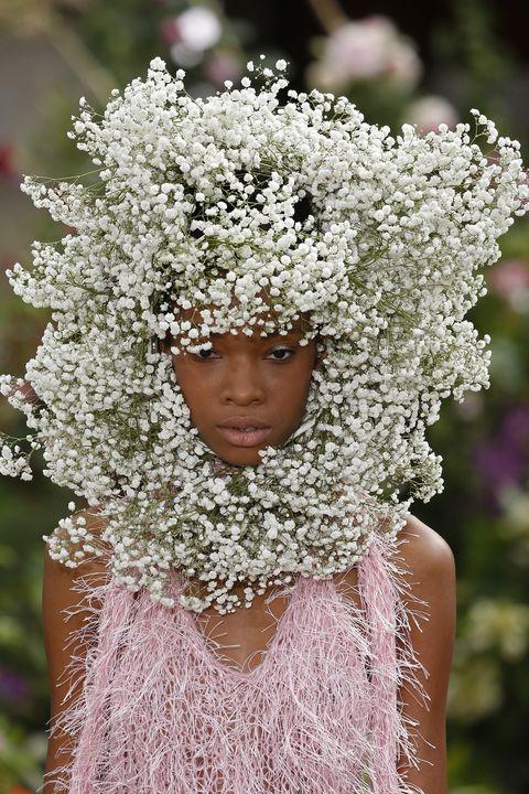 Headgear, Embellishment, Spring, Costume accessory, Headpiece, Tradition, Portrait photography, Annual plant,