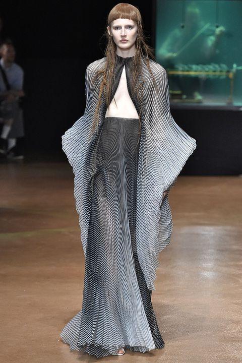Fashion model, Fashion, Runway, Clothing, Fashion show, Haute couture, Outerwear, Fur, Fashion design, Model,