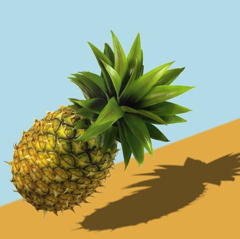 full length pineapple over pastel colored  background
