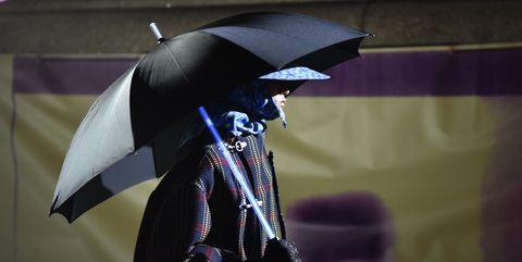 Umbrella, Purple, Violet, Magenta, Cloak, Sculpture, Mantle, Costume design, Rain,