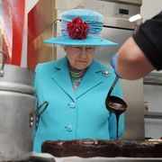 cumbria, england   june 5 no publication in uk media for 28 days queen elizabeth ii watches as a cook from the pie mill makes a chocolate cake at the cumbrian rural enterprise agency on june 5, 2008 in cumbria, england photo by pool tim graham picture librarygetty images