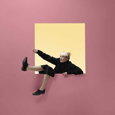 people moving threw portals in different shapes, in minimalistic studio setting in vivid colours
